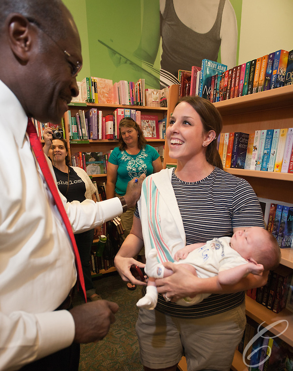 """Presidential candidate Herman Cain stopped in College Station, Texas to sign his book """"This is Herman Cain"""" on October 6, 2011. College Station is the home of Texas A&M University and the alma mater Cain's Republican rival Rick Perry."""