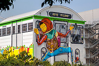 Milano. Efêmero, dei gemelli brasiliani Os Gêmeos, realizzato su un capannone dello spazio espositivo Hangar Bicocca,  raffigura un writer su un vagone della metropolitana --- Milan. Efêmero, by Brazilian twins Osgemeos, painted on a shed of exhibitions space HangarBicocca,  depicting a writer on a subway train