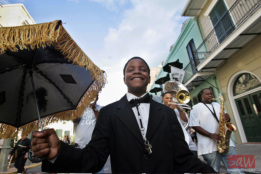"New Orleans, La.-  Two years after Hurricane Katrina, smiles and music have returned to New Orleans. Eric ""Mr. Groove"" Calhoun,12, marches with the Soul Rebels Brass Band during a parade down Royal Street in New Orleans French Quarter Friday, August  17, 2007. The parades, held each Friday during the summer are sponsored by the French Quarter business association to promote tourism during the slow summer months."