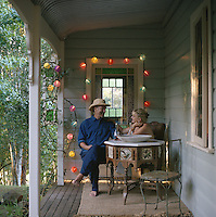 Designer Miv Watts and her partner Mike Gurney on the veranda of their Australian holiday home