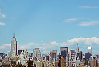New York: Panorama of Mid-Town Manhattan from Brooklyn Bridge. Empire State  & Metropolitan Lips Tower, left; Chrysler and Citicorp, right. Photo '91.
