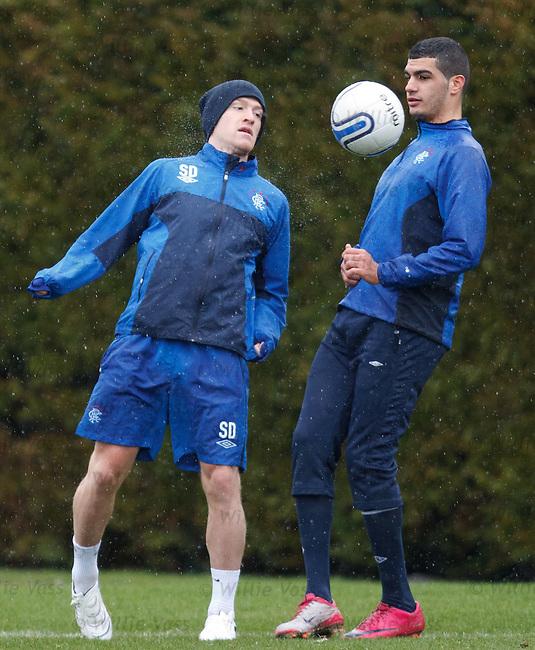 Steven Davis and Salim Kerkar tussle for the ball