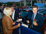 Orlando Bloom receive a flower from a fan on the red carpet during the 41st Deauville American Film Festival on September 6, 2015 in Deauville, France