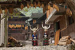 Miao women with silver adorned headpieces greet visitors into the village composed of centuries old wooden buildings.