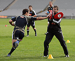 Asst. Coach Wayne Smith holds the gloves for Dan Carter at All Blacks training. Auckland, Wednesday 22 August 2007.