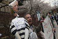 Washington, DC - March 31, 2016: A man, who requested to be identified as Hassan, holds an effigy of President Recep Tayyip Erdogan of Turkey as he protests outside of the Brookings Institution in the District of Columbia, March 31, 2016, ahead of Erdogan's speech at Brookings.  (Photo by Don Baxter/Media Images International)
