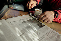 """December 17, 2011 - Laxe (La Coruña). Julio reads an article on the local newspaper about the percebeiros dealing with the bad conditions of the sea of the previous days. The title says """"Risking the life for 2 kg of percebes"""". © Thomas Cristofoletti 2011"""