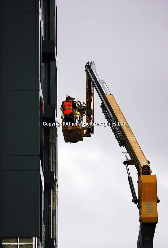 Pictured: Workers on a cherry picker remove cladding panels from Kennedy Gardens flats in Billingham. Tuesday 27 June 2017<br /> Re: Cladding is being removed by workers from the fascia of high-rise flats at Kennedy Gardens in Billingham, County Durham, England, UK