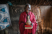 Alexandre Zilole (72), a traditional healer and a member of the Zion Church. He became a witchdoctor in 1999 after he was possessed by two spirits Lohanne and Yakobo. He claims that they are the spirits of John the Apostle and Jacob the Patriarch from the Bible.