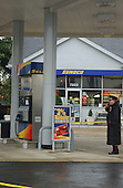 """Manassas, VA - October 10, 2002 --  A Prince William County Police officer looks at the gas pump the morning after a Gaithersburg man was murdered while pumping gas at a Sunoco station.  It is still unclear if the man is another victim of the """"Beltway Sniper"""".  <br /> Credit: Ron Sachs / CNP<br /> (RESTRICTION: NO New York or New Jersey Newspapers or newspapers within a 75 mile radius of New York City)"""