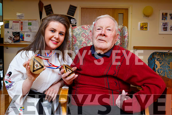 Katie O'Neill Mastergeeha shows Jim Hartnett the two gold medals she won at the Karate Worldwide Championships in Birmingham England to show her colleagues and residents of Our Lady Of Lourdes Nursing home Kilcummin last Friday