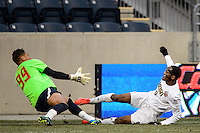 Notre Dame Fighting Irish forward Leon Brown (9) beats Maryland Terrapins goalkeeper Zack Steffen (99) to score during the championship match of the division 1 2013 NCAA  Men's Soccer College Cup at PPL Park in Chester, PA, on December 15, 2013.