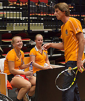 The Netherlands, Den Bosch, 16.04.2014. Fed Cup Netherlands-Japan, training, Kiki Bertens (L) and Richel Hogenkamp (NED) listen to captain Paul Haarhuis<br /> Photo:Tennisimages/Henk Koster