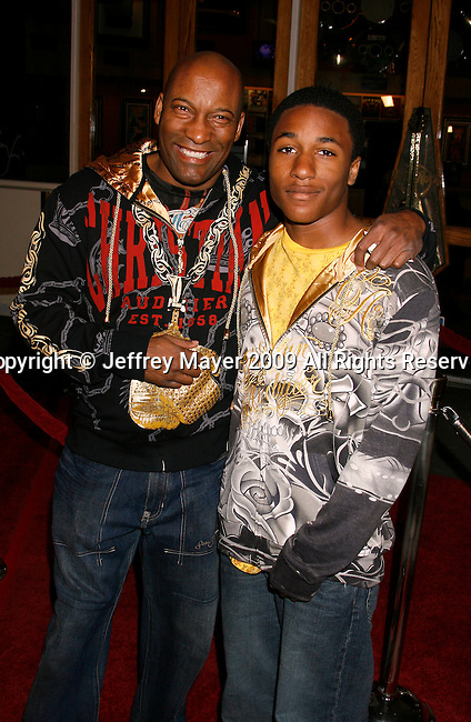 "UNIVERSAL CITY, CA. - March 12: John Singleton and son Masai arrive at the Los Angeles premiere of ""Fast & Furious"" at the Gibson Amphitheatre on March 12, 2009 in Universal City, California."
