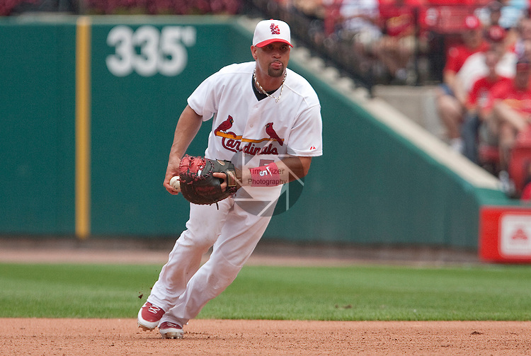 July 4, 2010          St. Louis Cardinals first baseman Albert Pujols (5) prepartes to underhand the ball to St. Louis Cardinals starting pitcher Adam Wainwright who moved to first base to cover for Pujols, and make the out.  The St. Louis Cardinals defeated the Milwaukee Brewers 7-1 in the final game of a four-game homestand at Busch Stadium in downtown St. Louis, MO on Sunday July 4, 2010.