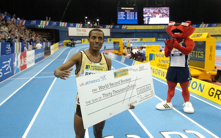 Photo: Richard Lane..Norwich Union Indoor Grand Prix, Birmingham. 17/02/2007. .Ethiopia's Kenenisa Bekele celebrates breaking the world record for the men's 2000m in a time of 4 minutes 49.99 seconds and a Norwich union cheque.