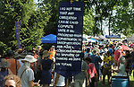A sign seen along a walkway, at the 2012 Clearwater Festival at Croton Point Park on Saturday, June 16, 2012. Photograph taken by Jim Peppler. Copyright Jim Peppler/2012