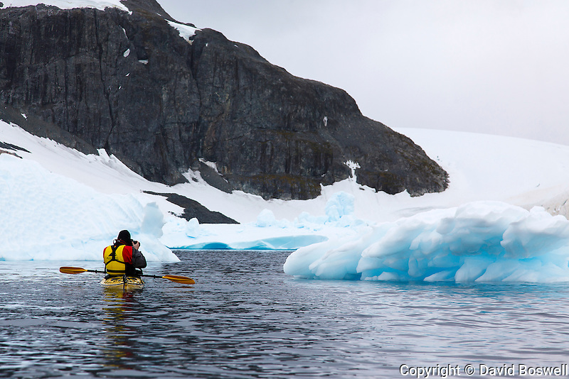 A sea kayak is a great way to explore and photograph the blue ice around Cuverville Island near the Antarctic Peninsula.