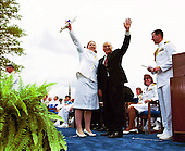 Following his commencement address to the United States Coast Guard Academy, Vice President Dick Cheney and Cadet Jen Frye, 22, of New Market, Virginia, wave to her friends and family after he presented the graduating cadet her commission in New London, Connecticut, Wednesday, May 19, 2004.  <br /> Mandatory Credit: David Bohrer / White House via CNP