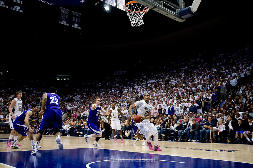 Trent Nelson  |  The Salt Lake Tribune.BYU forward Brandon Davies (0) dunks the ball. BYU vs. Portland, college basketball Saturday, February 25, 2012 in Provo, Utah.