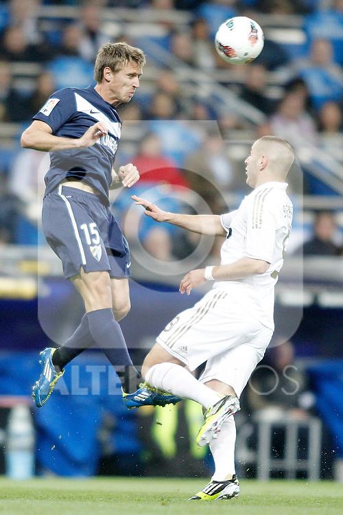 Real Madrid's Karim Benzema against Malaga's Nacho Monreal during La Liga Match. March 18, 2012. (ALTERPHOTOS/Alvaro Hernandez)