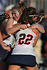 Shea Garcia #22 of Manhasset, right, gets congratulated by Madison Rielly #32 after scoring the game-winning goal with 44.8 seconds remaining of a Nassau County varsity girls lacrosse game against Long Beach at Manhasset High School on Friday, Apr. 15, 2016. Garcia's tally broke an 8-8 tie and lifted Manhasset to a 9-8 win.