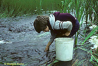 FS08-003b  Boy in stream looking for black fly larvae Maine.