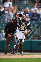 Rochester Red Wings catcher Carlos Paulino (17) backs up a play as umpire Roberto Ortiz looks on during a game against the Toledo Mudhens on June 12, 2016 at Frontier Field in Rochester, New York.  Rochester defeated Toledo 9-7.  (Mike Janes/Four Seam Images)