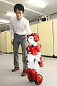June 18, 2010 - Tokyo, Japan - Japanese electronics giant Hitachi unveils a new version of the humanoid robot 'EMIEW2' that can converse while easily scooting around people on broken ground and can recognize and process human voices, in Tokyo, Japan, on June 18, 2010. Standing 80 centimetres tall and weighing just 14 kilogram, EMIEW2 was developed as part of Hitachi's efforts to create a service robot with diverse communication functions that could safely coexist with humans while conducting necessary services.