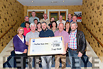 Kerry Parents and Friens Biddy Group presenting a cheque for &euro;7981 to Kerry Parents and Friends Assosiation in the Holiday Inn Hotel last Friday night.<br /> Front L-R Noreen Casey, Pat Moriarty, Mike Gallagher, Paul Cremin and Donie O'Doherty.<br /> Middle L-R Sarah Griffin, Nuala O'Doherty, Eileen Scully, and Kathleen Moriarty.<br /> Back L-R Phil Hannafin, Noel Lucey, Margaret Moynihan, Tim Kissane, Mary Kissane, John Duffy, Pauldie Kissane and Mike Kearney.