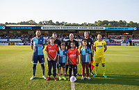 captains Paul Hayes of Wycombe Wanderers & Barry Fuller of AFC Wimbledon pose with Referee Charles Breakspear his officials & a group of Wycombe supporters ahead of the Friendly match between Wycombe Wanderers and AFC Wimbledon at Adams Park, High Wycombe, England on 25 July 2017. Photo by Andy Rowland.