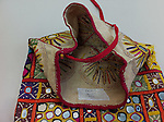 ANTIQUE DOWRY BAG WITH FINE MIRROR EMBROIDERY FROM THE RJPUT COMMUNITY OF KUTCH GUJARAT