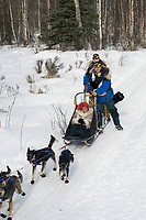 Martin Buser w/Iditarider on Trail 2005 Iditarod Ceremonial Start near Campbell Airstrip Alaska SC