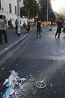 Roma,15 Ottobre 2011.Manifestazione contro la crisi e l'austerità..Corteo e scontri con le forze dell'ordine.Nella foto: la statua della madonna di Lourdes sottratta dalla parrocchia di san Marcellino e Pietro in via Labicana e l'incendio di automobili