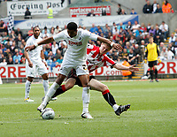 Npower Championship, Swansea City FC (white) V Sheffield United. Sat 7th May 2011 (12.45pm KO)<br /> Pictured: Scott Sinclair of Swansea shakes off the tackle from Rob Kozluk<br /> Picture by: Ben Wyeth / Athena Picture Agency<br /> info@athena-pictures.com<br /> 07815 441513