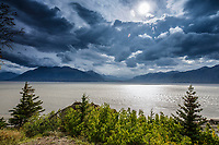 Fall landscape of clouds over Kenai Mountains and Turnagain Arm taken from hike along Seward Highway south of Anchorage, Alaska  September 2015