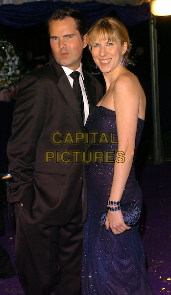 JIMMY CARR & PARTNER.British Comedy Awards 2005 Arrivals, London..UK, United Kingdom..14th December 2005.Ref: CAN.half length black suit tie navy blue sparkly strapless dress pouting pout funny funnies expression.www.capitalpictures.com.sales@capitalpictures.com.©Capital Pictures