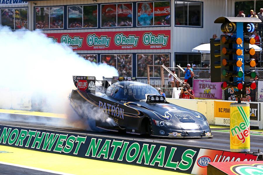 Aug. 3, 2014; Kent, WA, USA; NHRA funny car driver Alexis DeJoria during the Northwest Nationals at Pacific Raceways. Mandatory Credit: Mark J. Rebilas-USA TODAY Sports