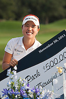 November 20, 2011: Hee-Young Park (South Korea) holds the winners pay on the 18th green to win the 2011the CME Group Titleholders held at The Grand Cypress Resort, Orlando, Fla.