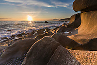 Coastal landscape of rocky beach at sunset along the Gulf of Alaska and the fairweather mountain range.