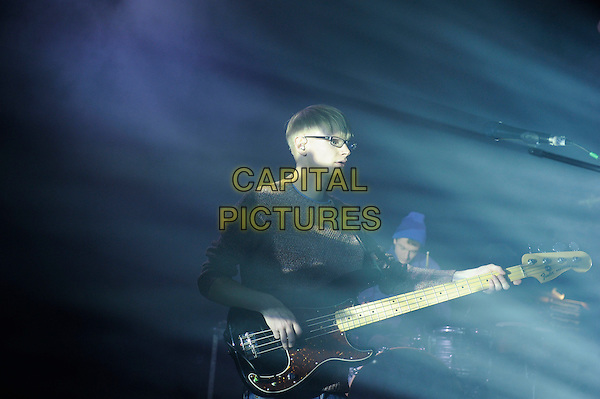 Gwil Sainsbury of Alt-J.Alt-J performing in concert, Shepherd's Bush Empire, London, England, UK,.19th January 2013..music live performing on stage concert gig half length guitar playing glasses jumper  .CAP/MAR.© Martin Harris/Capital Pictures.