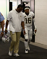 Georgia Tech quarterback TaQuon Marshall (16) limps off the field after pregame warmups. The Pitt Panthers football team defeated the Georgia Tech Yellow Jackets 24-19 on September 15, 2018 at Heinz Field in Pittsburgh, Pennsylvania.