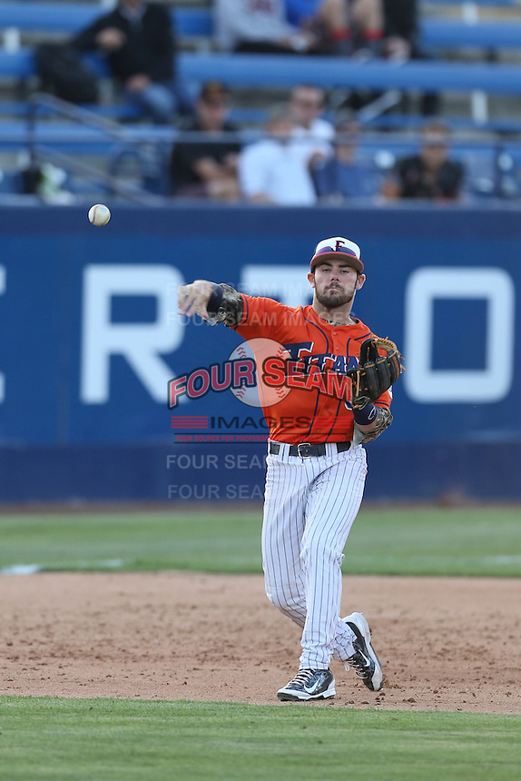 Dustin Vaught (31) of the Cal State Fullerton Titans makes a throw during a game against the Cal Poly Mustangs at Goodwin Field on April 2, 2015 in Fullerton, California. Cal Poly defeated Cal State Fullerton, 5-0. (Larry Goren/Four Seam Images)
