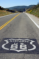 Black and White painted Route 66 sign symbol on road,