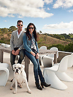 Portrait of Nuno and Mexia Carmo Benito, owners and designers of Carpet Diem rugs, on the terrace of their Portuguese holiday home