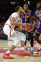 NWA Democrat-Gazette/ANDY SHUPE<br /> Arkansas forward Daniel Gafford (left) attempts a shot in the lane as he is pressured by LSU forwards Kavell Bigby-Williams (11) and Naz Reid Friday, Jan. 11, 2019, during the first half of play in Bud Walton Arena in Fayetteville. Visit nwadg.com/photos to see more photographs from the game.