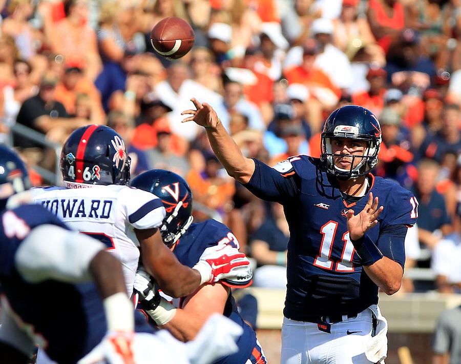 Virginia quarterback Greyson Lambert (11) throws in traffic during the game against Richmond Saturday Sept. 6, 2014 at Scott Stadium in Charlottesville, VA. Virginia defeated Richmond 45-13. Photo/Andrew Shurtleff