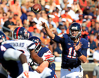Virginia quarterback Greyson Lambert (11) throws in traffic during the game against Richmond Saturday Sept. 6, 2014 at Scott Stadium in Charlottesville, VA. Virginia defeated Richmond 45-13. Photo/Andrew Shurtleff