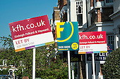 Estate agents signs at a house in West Hampstead, London.
