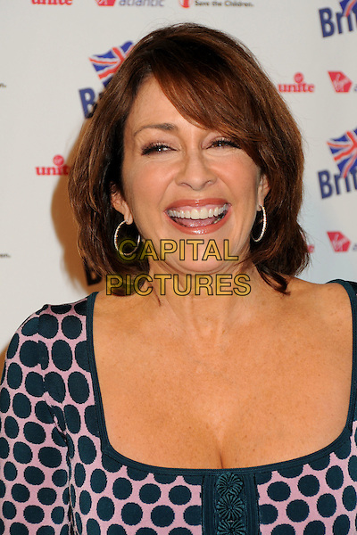"PATRICIA HEATON .BritWeek 2010 Charity Event: ""Save The Children and Virgin Unite"" held at the Beverly Wilshire Hotel, Beverly Hills, California, USA, 22nd April 2010..portrait headshot navy blue and pink polka dot smiling cleavage hoop earrings mouth open smiling .CAP/ADM/BP.©Byron Purvis/AdMedia/Capital Pictures."